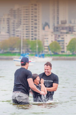 Christ City pastor Brett Landry baptizes a new  believer at Kits Beach in Vancouver. Photos: courtesy C2C Network