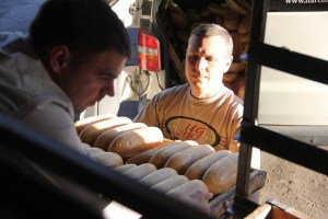 Vlad Makhovskiy (right) with Dmitriy Lichiman (left), another volunteer, prepare bread for distribution to Donetsk and Lugansk.