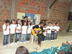 Participants of Education Brings Hope perform a song at their graduation. The El Progreso neighborhood still has no water or sewer and faces regular gang violence. Education Brings Hope is a Global Family program that provides salaries, food and teaching supplies for a preschool and primary school of the Colombian Mennonite Brethren Church. Credit: Colombian Mennonite Brethren Church