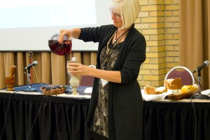 Mary Anne Isaak prepares communion elements during the evening worship session at MCC Canada's 2016 annual general meeting. MCC photo/Rachel Bergen