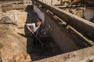 Democratic Peoples Republic of Korea (DPRK) is an MCC country of sensitivity. Please follow MCC Communications content vetting guidelines (below) before using these photos. Media caption: Kum-Hyok Kim, 11, helps his grandmother, Bong-Suk Shin, 65, whom he lives with, look through the rubble of their home for anything they can salvage. Their home was destroyed in flooding due to Typhoon Lionrock. (MCC Photo/John Lehmann)   Extra information: Kum-Hyok Kim, 11, helps his elderly grandmother, whom he lives with, look through the rubble of their home for anything they can salvage. It was destroyed in flooding due to Typhoon Lionrock. Kim and his grandmother live in Yonsa County, Democratic People's Republic of Korea (DPRK), also known as North Korea. From August 28 to September 2, heavy rains caused by Typhoon Lionrock pounded northeast part of DPRK, causing flooding and landslides in six counties of Hamgyong province. According to the UN, 138 people were killed, more than 69,000 are still displaced and 600,000 people are in need of assistance. DPRK is a chronically food-insecure country which is prone to disasters, particularly flooding. MCC's partnerships in the country meant hundreds of people received relief kits and food shortly after the flooding took place. In September, MCC's partner, Christian Friends of Korea (CFK), distributed 500 MCC relief kits and 110 school kits to respond to the flooding in Musan and Yonsa counties. In addition, MCC, through First Steps, will purchase 6,060 square meters of corrugated steel roofing for rebuilding damaged daycares, kindergartens, and clinics in Yonsa. Approximately 4,200 children will benefit from this project.