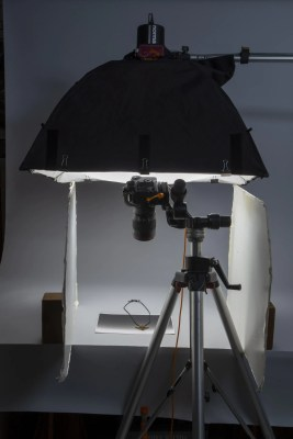 Light source above object on table top; white foam core on each side of object and camera aimed down at object.
