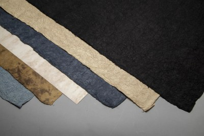 assortment of handmade papers to use as a background for photos. Photo  George Post