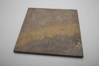 Square of colored slate to be used as a background material