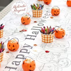 Detail of table setting with treats and crayons