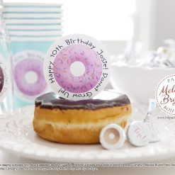 donut themed cupcake topper on a chocolate iced donut