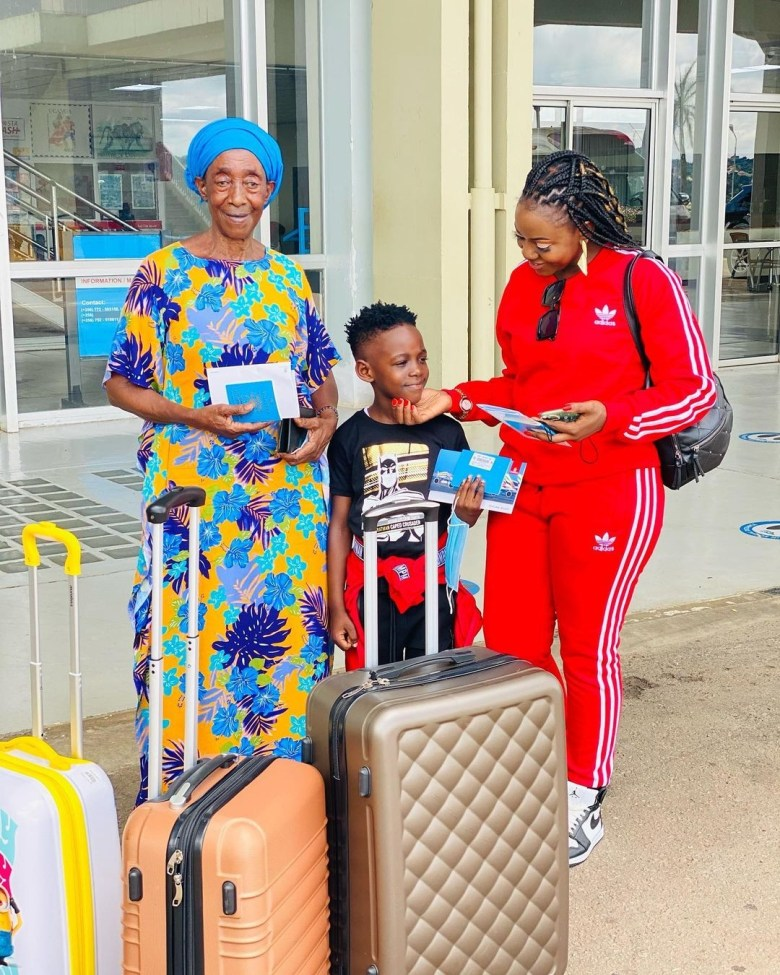 Remmie, mum and son at Entebbe Airport before setting off