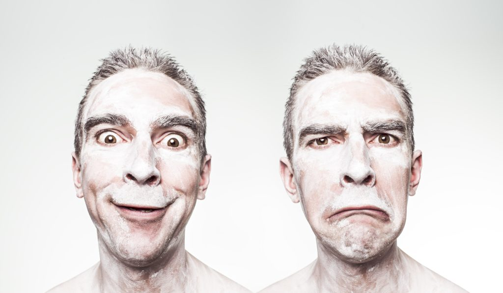Man with powdered face making two expressions
