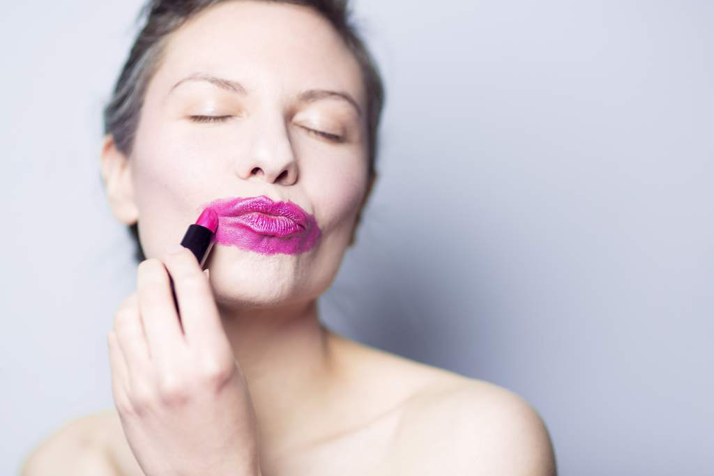 woman with lipstick all over her mouth
