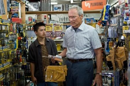 """Eastwood (sort of) befriends neighbor Thao (Bee Vang) in """"Gran Torino."""""""