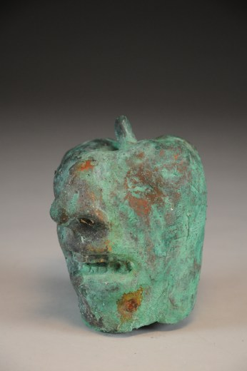 Bronze Apple with human face