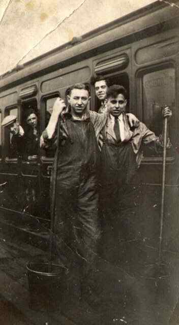 Stan with Carriage Cleaners in Sheffield. Stan is second from the left, looking out of the carriage window.