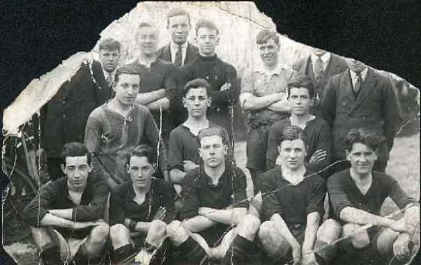 Stan in a football team. The year isn't known, but he looks quite young. Stan is on the front row, second from the right.
