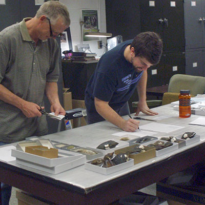 Curator Gerald Dinkins and a graduate assistant in the Paul W. Parmalee Malacological Collection lab.