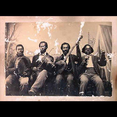 African American musicians in minstrel line, c. 1860s, albumen print. Courtesy of Jim Bollman.