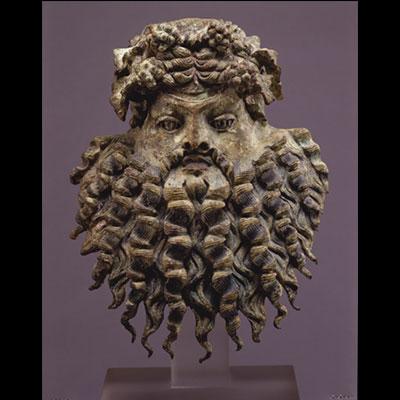 Bronze Dionysiac Mask; Vessel applique, Greco-Roman; first century BC, Ht. 7 3/4 in.