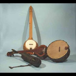 """(top) """"Old Plantation"""" gourd; banjo, c. 2005, length 35 in. Courtesy of Pete Ross, maker; (middle) Philadelphia Centennial banjo, c. 1876, length 37 in. Collection of Jim Bollman; (bottom) Senegalese xalam, c. 1850, length 25 in. Collection of Peter Szego."""