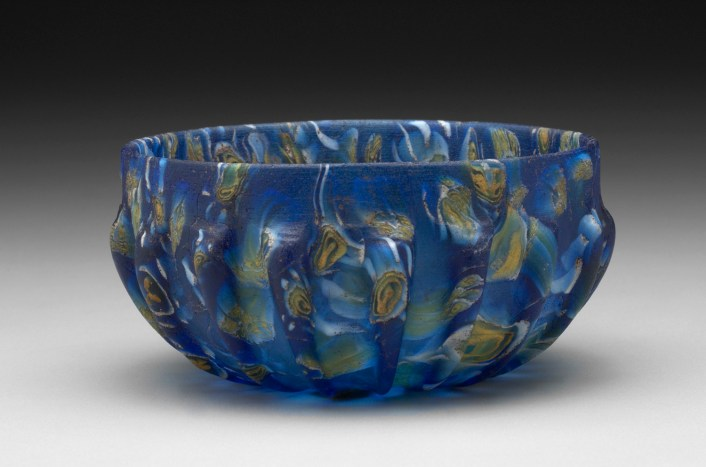 Deep Ribbed Bowl, Eastern Mediterranean, Alexandrian?, Graeco-Roman, 1st century B.C. – 1st century A.D. Dark blue glass with yellow and white, Yale University Art Gallery, Hobart and Edward Small Moore Memorial Collection, Bequest of Mrs. William H. Moore, 1955.6.17.
