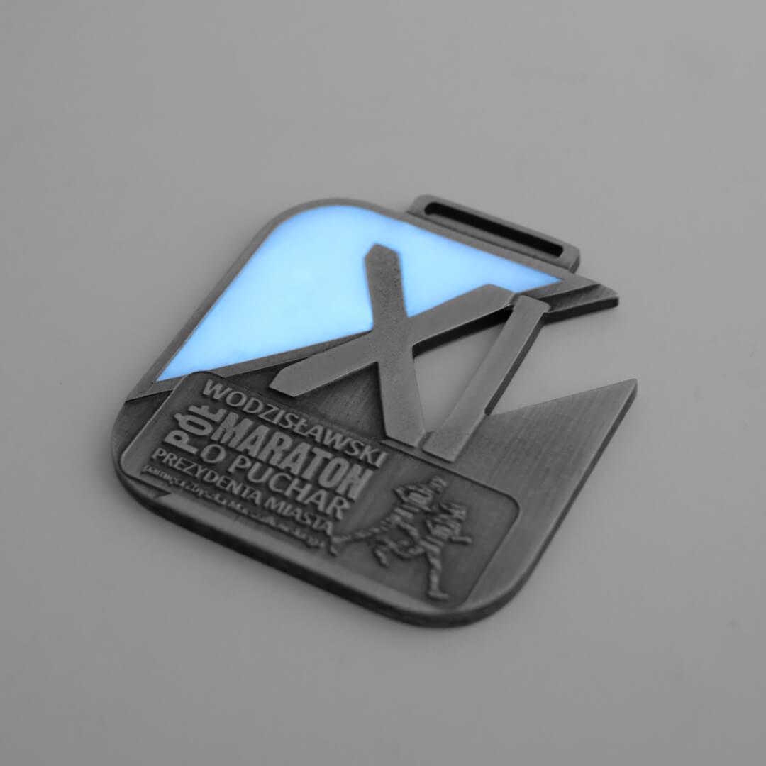 Świecący medal wykonany przez MCC Medale