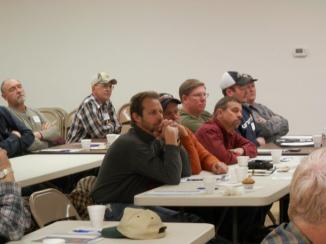 Local producers listening to speaker