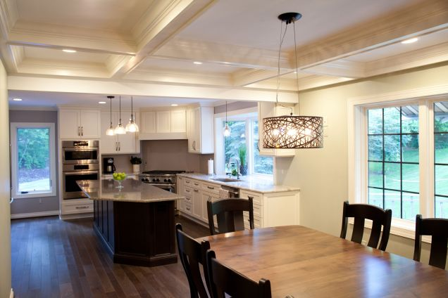 White kitchen cabinets with wood island