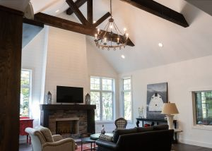 Living room with fireplace and timber trusses