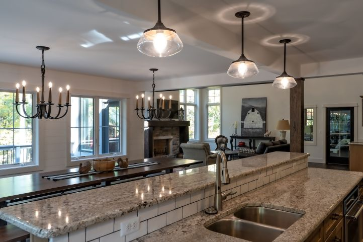 Granite island with subway tile back splash looking into dining area
