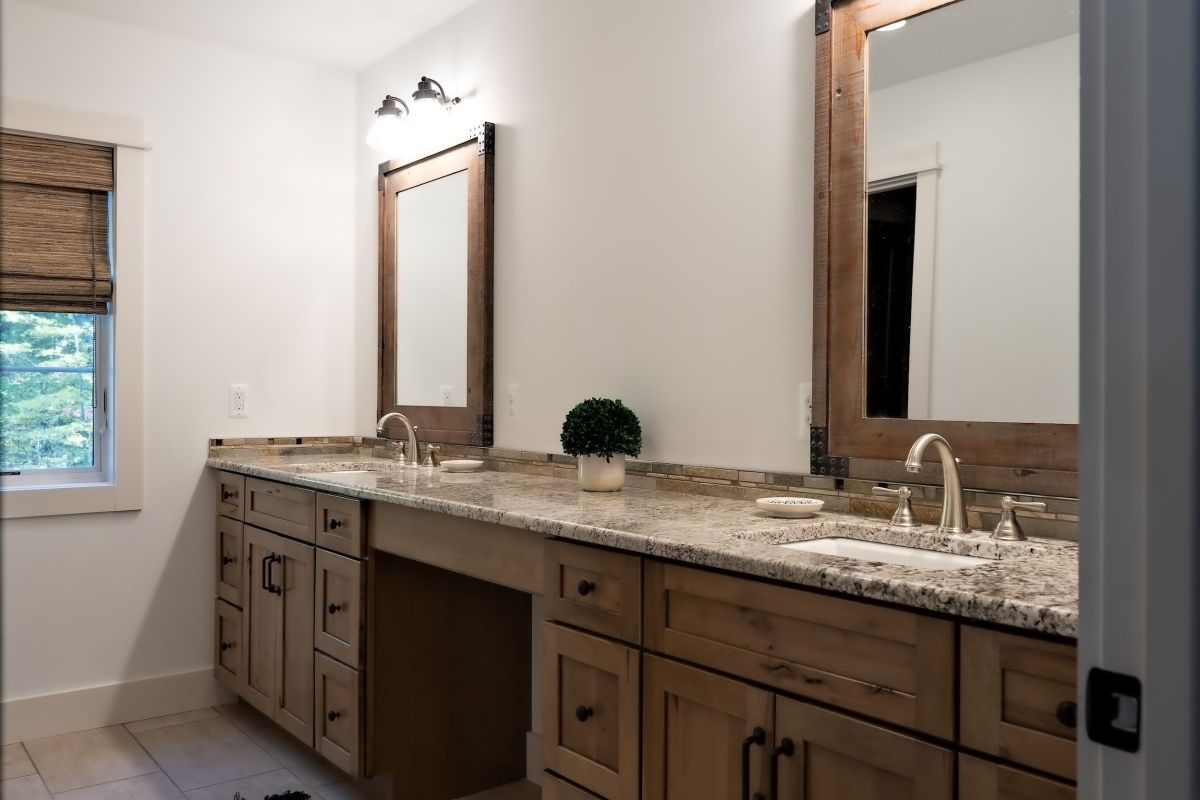 Granite counter on wood cabinets with vanity area
