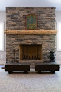 Stone fireplace with wood mantle