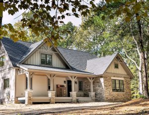 Covered porch along front of house inspired by cottage feeling