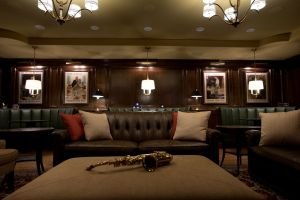 Leather furniture in wood paneled room