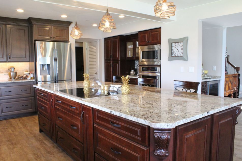 Large granite island with wood cabinets