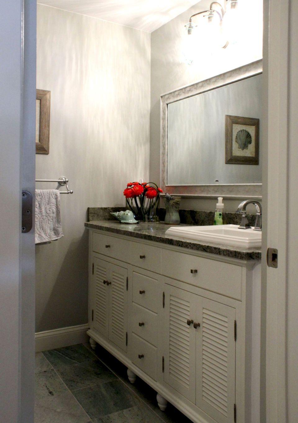White vanity cabinets with granite counter