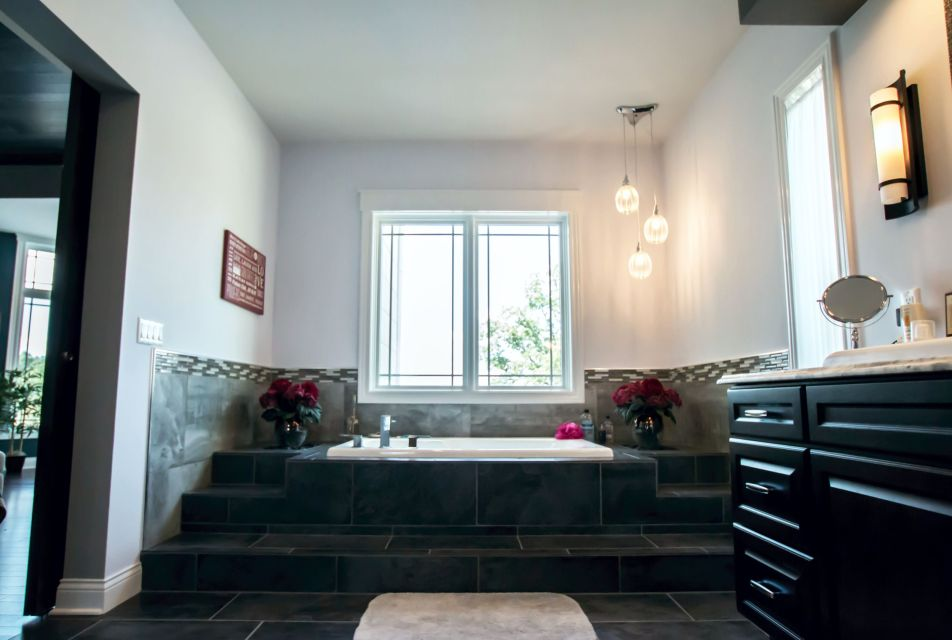 Large soaking tub in tiered tile deck