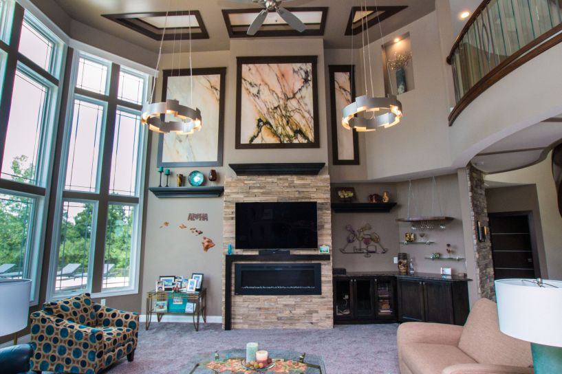 Modern linear gas fireplace with stone surround