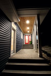 Red door draws your eye up through a covered porch