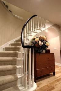 Curved staircase with painted white treads and balusters