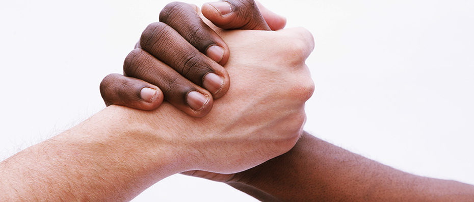 antiracism black and white holding hands