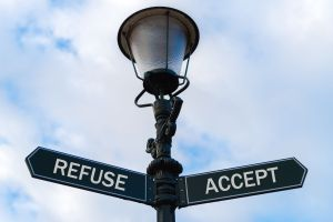 lamp post with two options, refuse or accept, signifies options in turning the mind