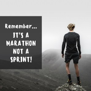 """Man standing on a mountain with the caption """"remember... it's a marathon not a sprint!"""""""