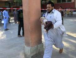 RESCUE WORKER RUSHES INJURED CHILD TO JALALABAD HOSPITAL