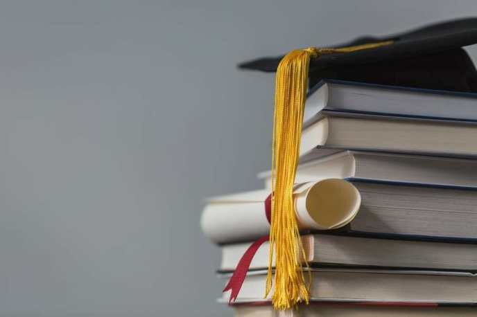 books-with-graduation-cap-and-diploma_925x