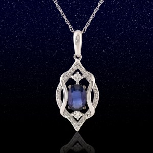 white gold pendant with oval sapphire and diamond side stones