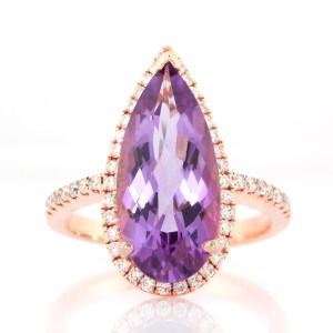rose gold diamond halo ring with pear shape amethyst