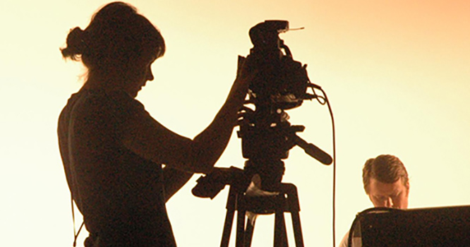Female behind the camera in a studio