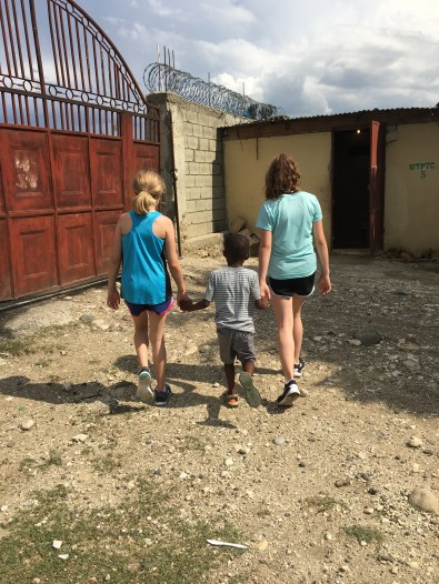 Walking his big sisters out to see the chickens and eggs!
