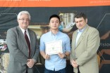 Shuai Yang with Dean Lague (L) and Canadian Soceity for Civil Engineering representative (R).