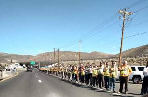 Photos courtesy of Mineral County Sheriff Randy Adams NDOT workers join officers and many others to honor the life of Carson City Sheriff Deputy Carl Howell as his funeral procession made its way to Reno last Thursday. Howell was gunned down on Aug. 15 responding to a domestic violence call in the state capital.