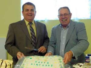 Courtesy photo First Southern Baptist Church everend Kevin White and Pastor Mike Fontaine share in the churches 68th birthday cake.