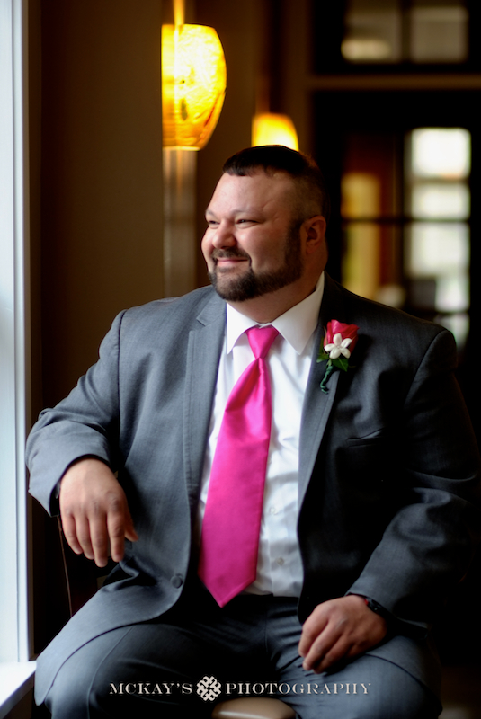 posing a plus sized Groom on his wedding day at Jack's Place Rochester